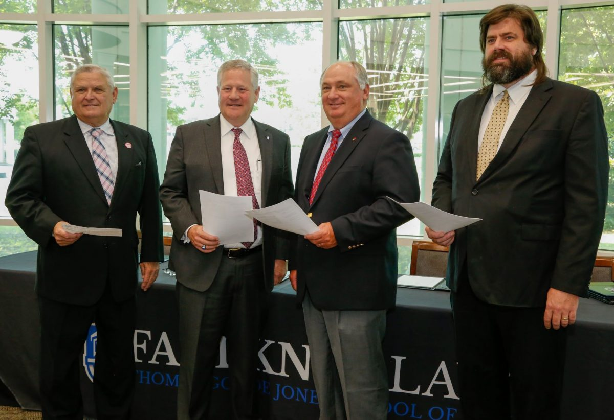 l-r Commissioner Rick Pate, Faulkner President Mike Williams, Federation President Jimmy Parnell, and NALC Director Harrison Pittman pose after signing a memorandum of understanding to establish a three-year Alabama Ag Law Pathway.